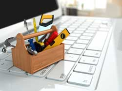 Image of a miniature toolbox on a laptop keyboard